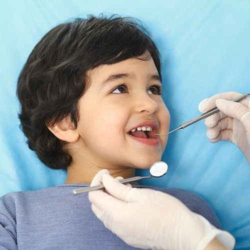 Child receiving dental checkup