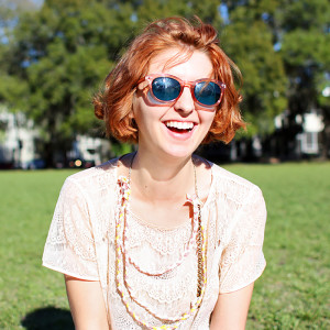 girl wearing sunglasses and smiling