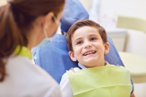 Boy smiling during visit with children's dentist in Arlington Heights