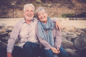Older couple smiling after using tips for dentistry for seniors