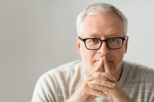 Older man thinking about dental implants
