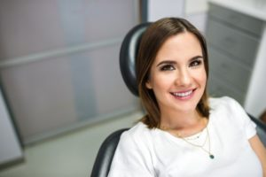 Woman smiling during her appointment with a family dentist